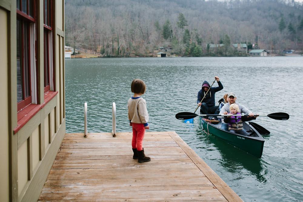 Image of girl standing on dock waiting for canoe