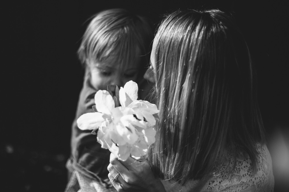 image from family documentary session of mother and daughter with flowers
