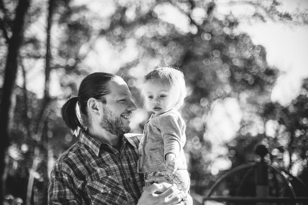 Image from family documentary session of father holding daughter