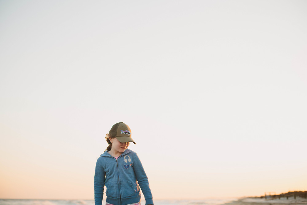 Image of girl on during a sunset on the beach