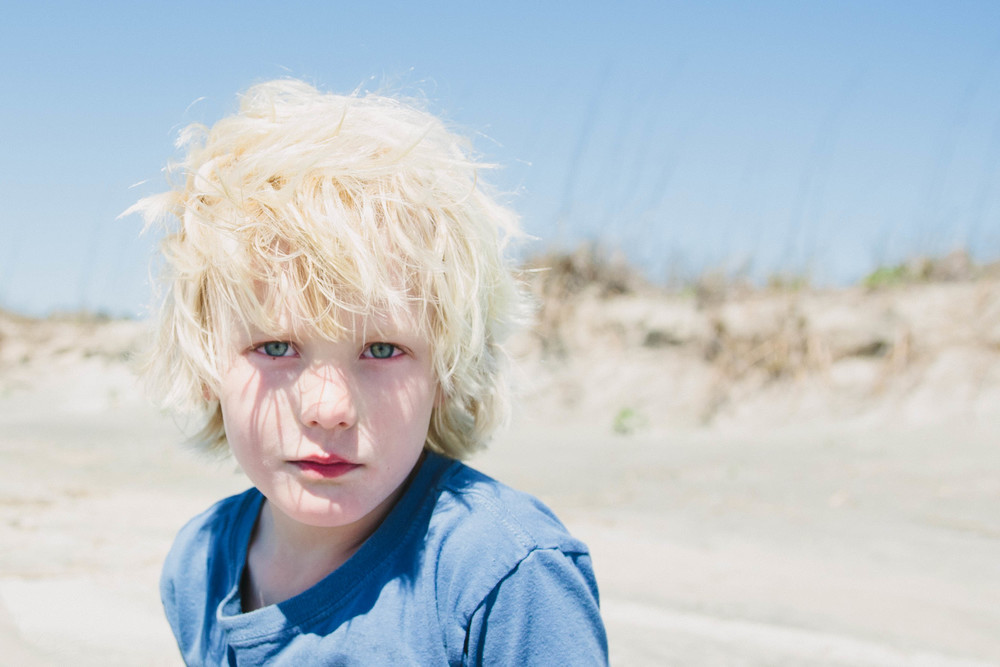 Image of fair skinned boy with blue eyes looking at the camera