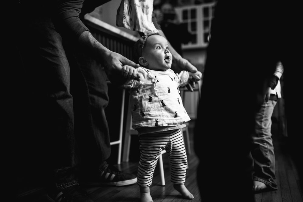 baby dancing in the kitchen from family documentary photography session in atlanta