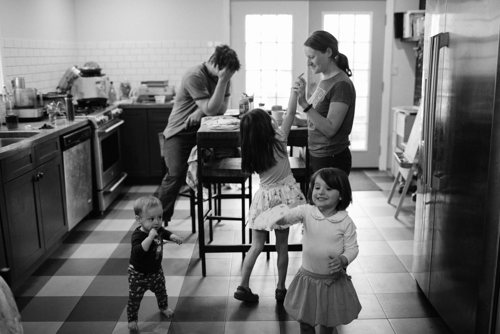 a family portrait in a kitchen with a tortilla