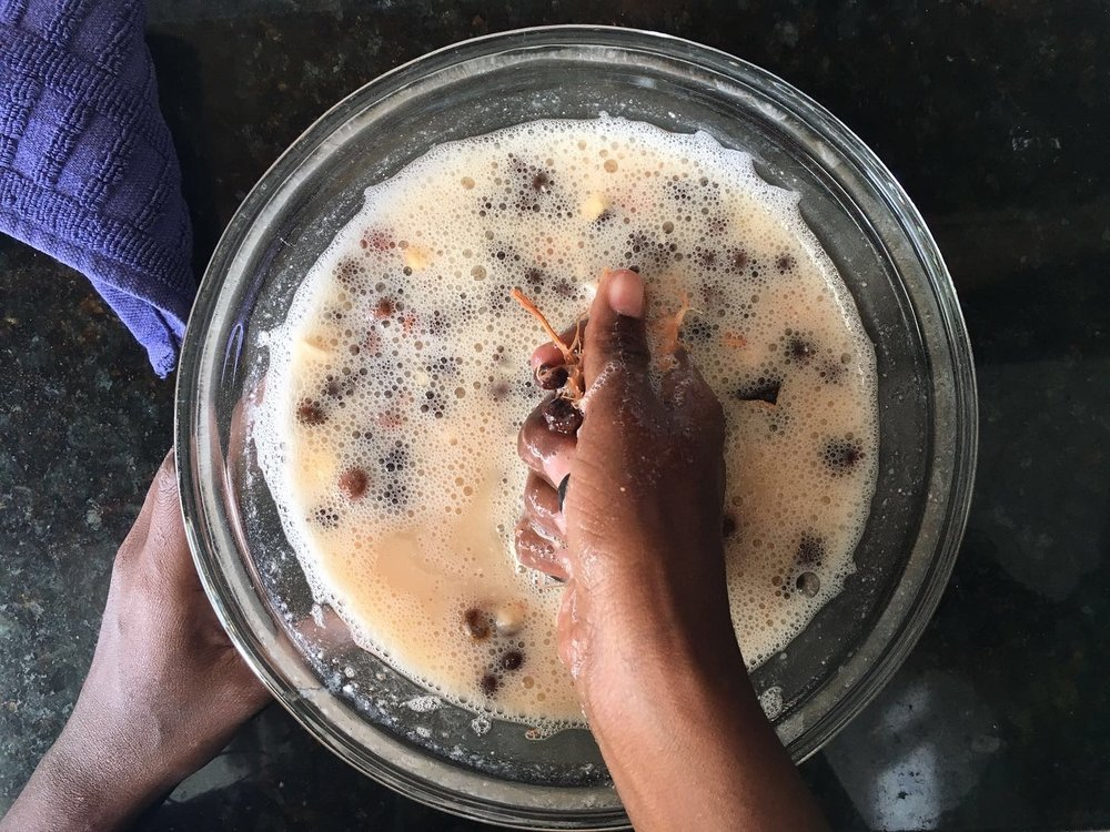 Preparing gongoleis, a.k.a baobab fruit juice, involves soaking the hard fruits and then squeezing the pulp from the seed. Ignore the ashy hand (it's the lighting, I swear)