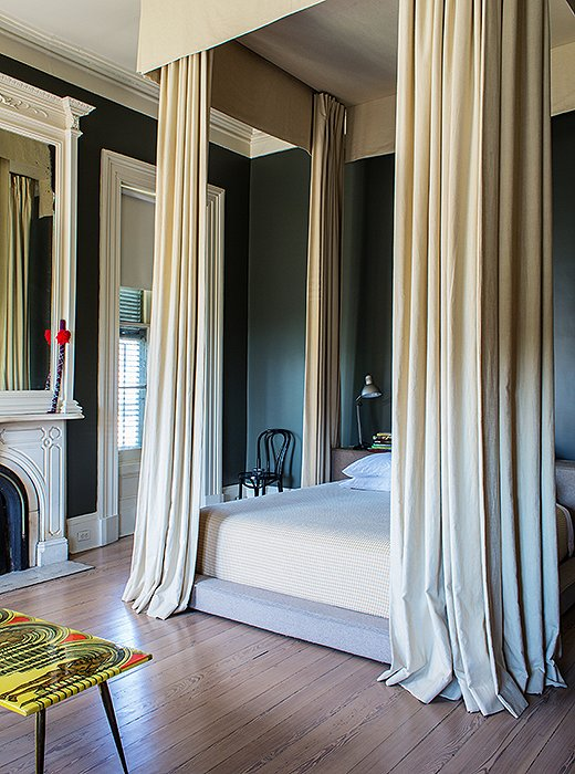 "Maximalist in their sweep (""it's super Game of Thrones, isn't it?"" says Sara) but minimalist in form (they feature no swags or trims) the beige linen canopy curtains in the master attach to the ceiling. ""If everything is low, you feel like you're lost in space."""