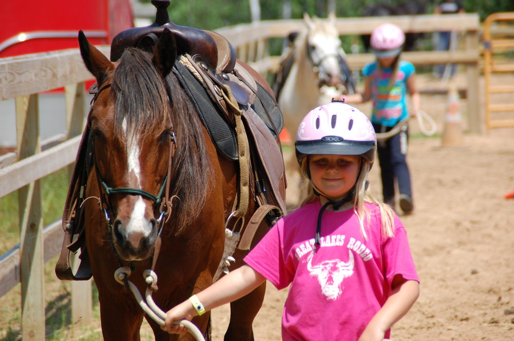 Homestead & Explorer campers can enhance their classic camp experience with the Pony Express Elective. Join us for an hour each day to learn how to care for a friendly horse.  Hands on clinics will include horse safety, grooming, leading, saddling, mounting, basic riding skills and a mini trail ride on Friday (weather permitting)! Space is limited to 6 campers per week to ensure a quality program and safe environment. Homestead Mini campers are welcome to participate in Pony Express for their two full days at camp for a discounted price of $20.  They will be learning horse safety, grooming, leading, and saddling.