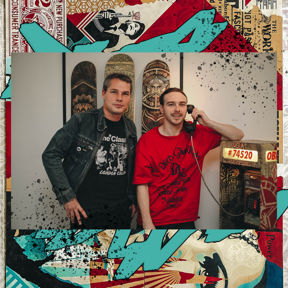 SHEPARD FAIREY AND JOHN TRACY STAND IN FRONT OF TRACY'S FIRST PHONEBOOTH FROM SK8 ART SHOW / PHOTO CREDIT: SHEPARD FAIREY /  DESIGN CREDIT: VANESSA ACOSTA