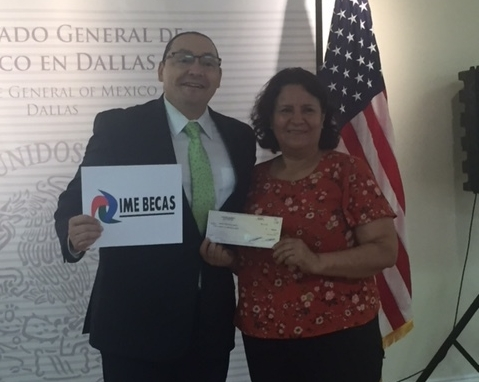 Aberg Center student Maria Torres accepts the check from the Mexican Consolate's IME BECAS program.