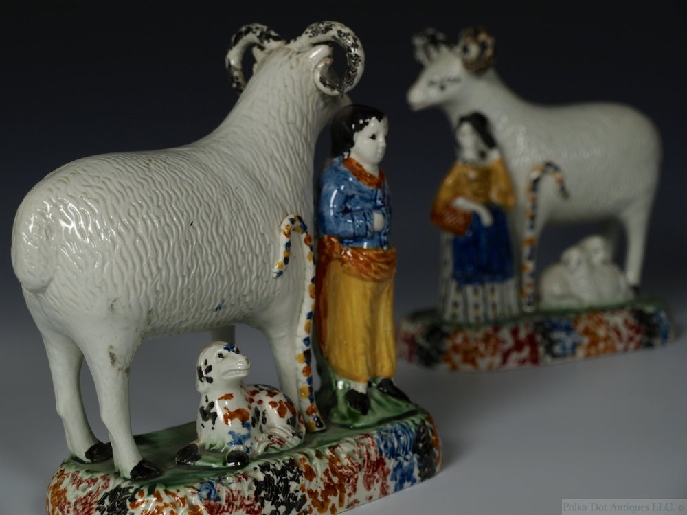 "Pair of Prattware Rams with Shepherd and Shepherdess, c.1800-20, 6¼"" high. (Provenance – Sotheby's 27-2-68. Lot – 18.)"
