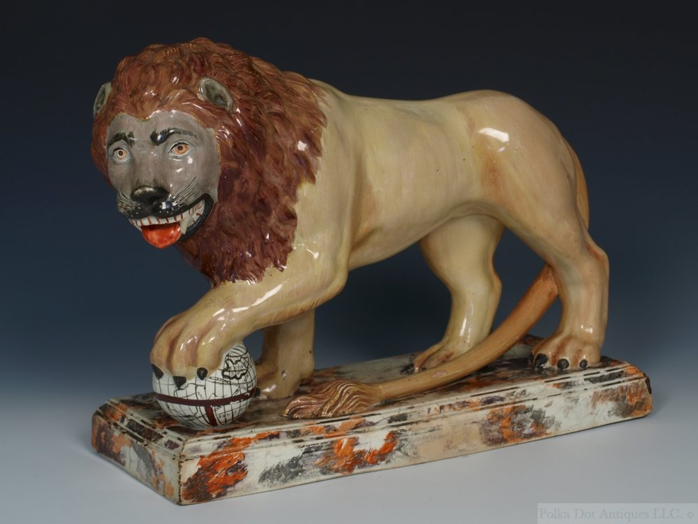 "Stafordshire pottery figure of a Lion, c.1810-20, 9"" high by 12"""