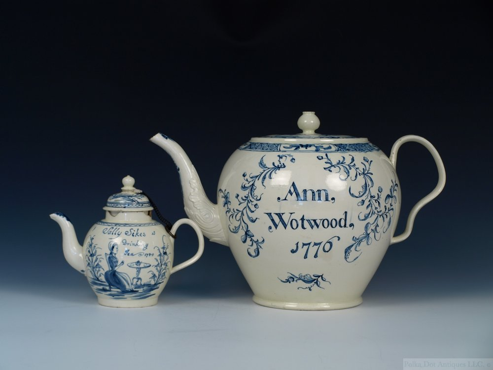 "English Creamware Blue and White Named and Dated Punch Pot and Cover, 1776, painted name ""Ann Wotwood, 1776,"" 10¼"" high."