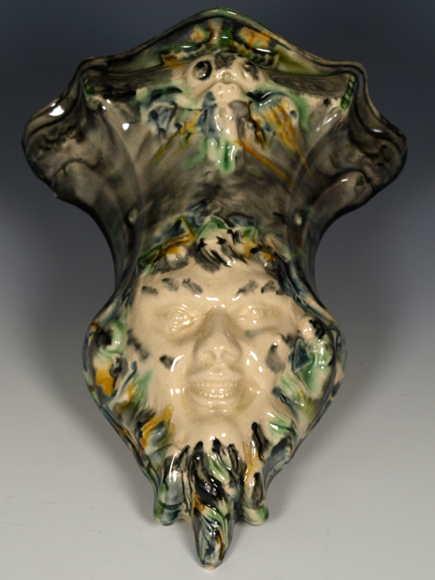 "Staffordshire Creamware Satyr Mask Wall Pocket, 1770/80s, 8½""."