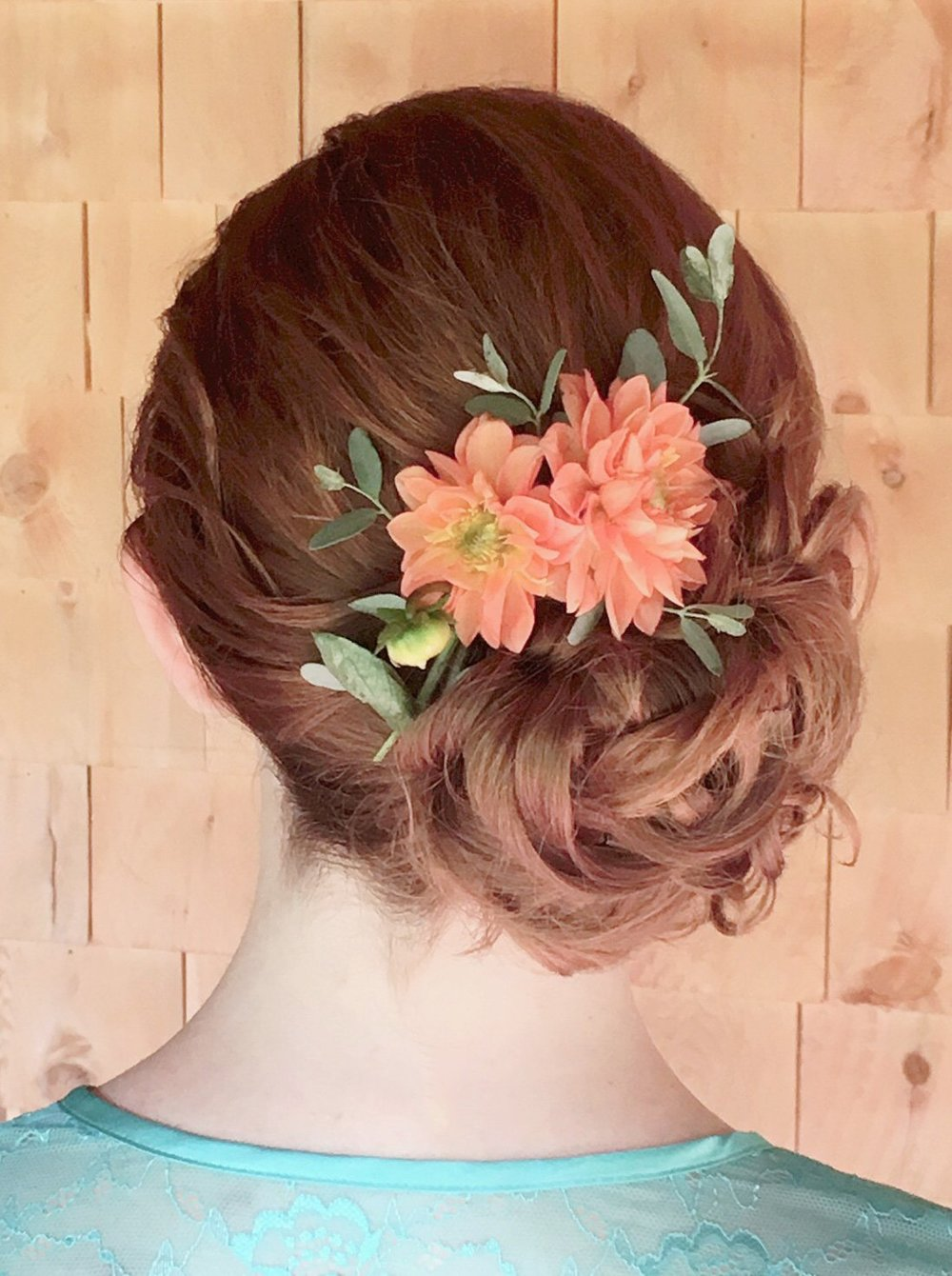 Flower in updo red hair by Lari Manz