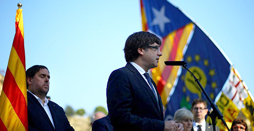 Catalan President Carles Puigdemont delivers a speech at the memorial of 'Fossar de la Pedrera' in Barcelona on Sunday. Photo courtesy of Reuters as shown on the Independent.