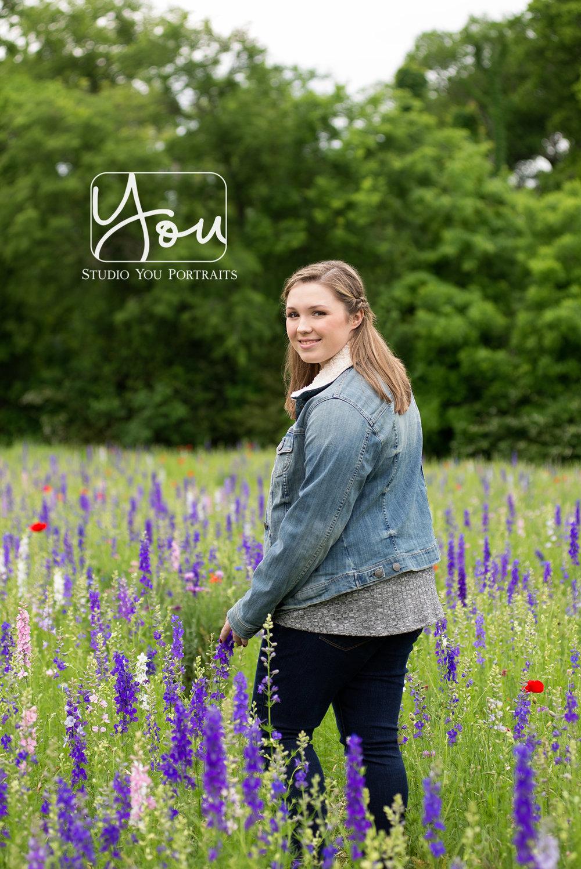 Senior girl with wildflowers.