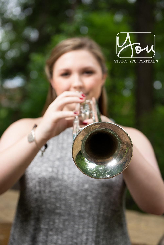 Senior girl with trumpet.