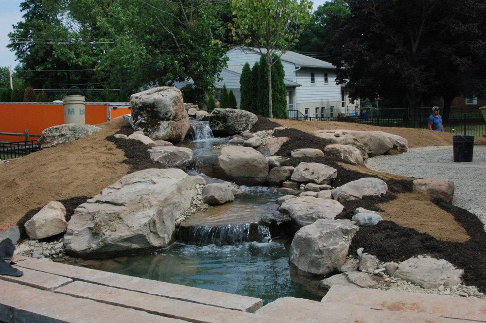 Pondworks_bridge_design build_custom_boulders_pond.JPG