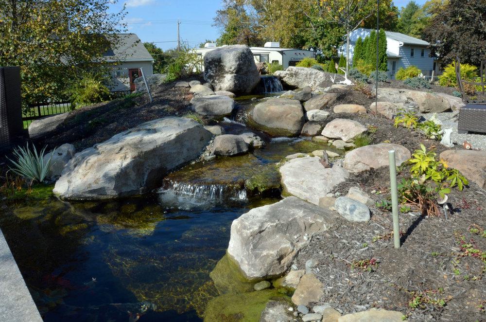 Pondworks_pond_waterfall_boulders_bog.jpg