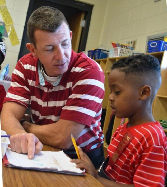 Reading Partners, which uses community volunteers to work with students, is one of the Charleston school system's programs.