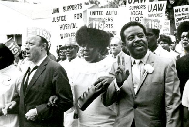 Rev. Ralph Abernathy, President of the Southern Christian Leadership Conference, right, marches with Local 1199B President Mary Moultrie and United Auto Workers President Walter Reuther during local hospital workers' strike in 1969. PHOTO CREDIT: Avery Research Center, College of Charleston.