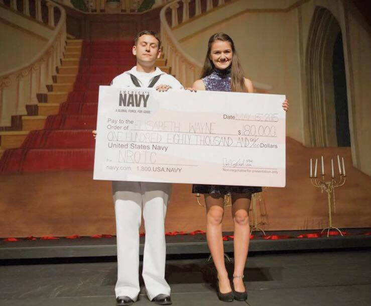 We are so proud of all of our graduating seniors! In 2015, former PO2 Elisabeth Wa  yne received a ceremonial check from the Navy for NROTC at her high school's senior awards event.