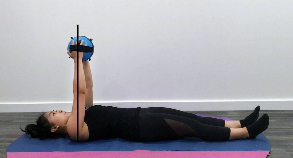 In this chest press exercise we can see how Yvonne is forming a straight line with her arm and a 90 degree angle with her shoulder. She maintains this line as she presses the Gravity Ball up and away from her chest during the press.