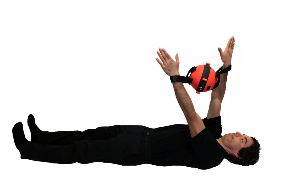 Dr. Chavez demonstrates a symmetry enhancing exercise for the shoulders and upper back. This movement can be done while lying, sitting or standing. Sliding both arms through the loop straps and pulling away from the center of the weight, he is strengthening his shoulder joint and the muscles of the rotatory cuff. While keeping tension, he is able to raise or lower his arms and can also do lower body movements such as a squat or lunge if in a standing position.