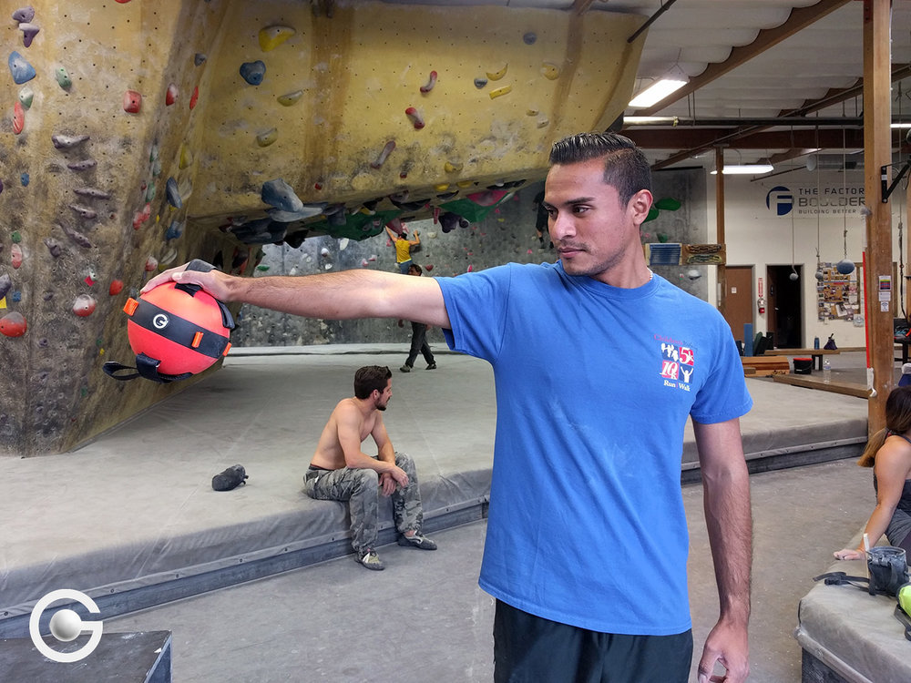 An orange 7 lbs Gravity Ball is perfect for supplementary training if you're a rock climber.