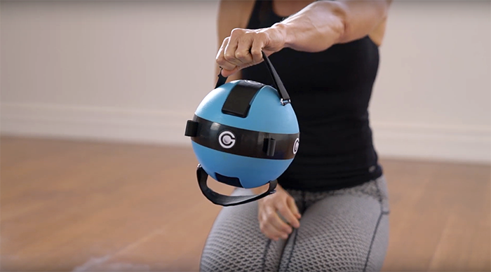 The Gravity Ball's adjustable straps can be used to replicate a kettlebell's handles