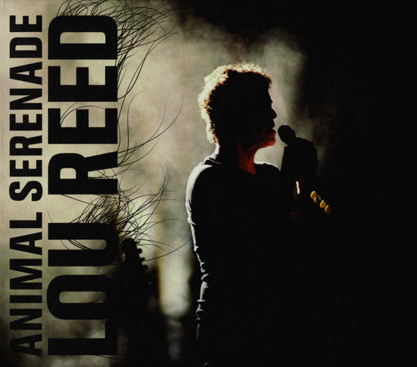 """Lou Reed """"Animal Serenade""""   Lou Reed's live album recorded in Los Angeles at the Wiltern Theatre in 2003 after his solo album The Raven. This 3LP set is on vinyl for the first time. Features classics """"Dirty Blvd"""", """"How Do You Think It Feels"""" and """"Sunday Morning"""". In addition, Anohni, of Antony and the Johnsons fame, contributes background vocals throughout and sings the lead on """"Set The Twilight Reeling"""" and """"Candy Says."""""""