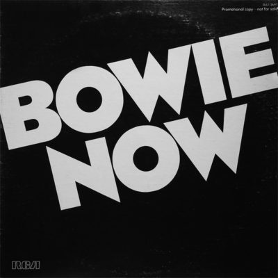 """David Bowie """"Now""""   This is the first commercial release of a rare 1977 US compilation LP on white vinyl, which was originally only a promotional release. The tracks are drawn from the Low and """"Heroes"""" albums (all audio remastered from the """"A New Career In A New Town"""" box set). The package now features a newly designed inner sleeve with black and white images taken in Berlin in 1977 by Corrine Schwab."""