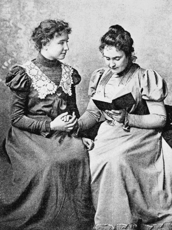 Helen Keller in 1899 with Anne Sullivan. Photo taken by Alexander Graham Bell at his School of Vocal Physiology and Mechanics of Speech.