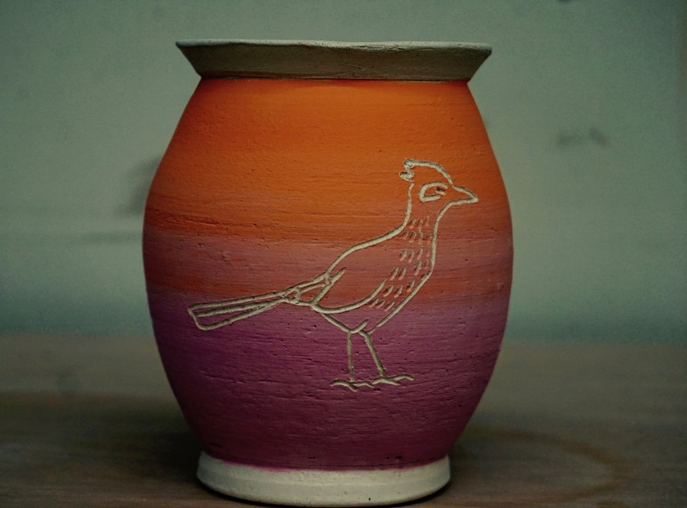 pot decorated with bird