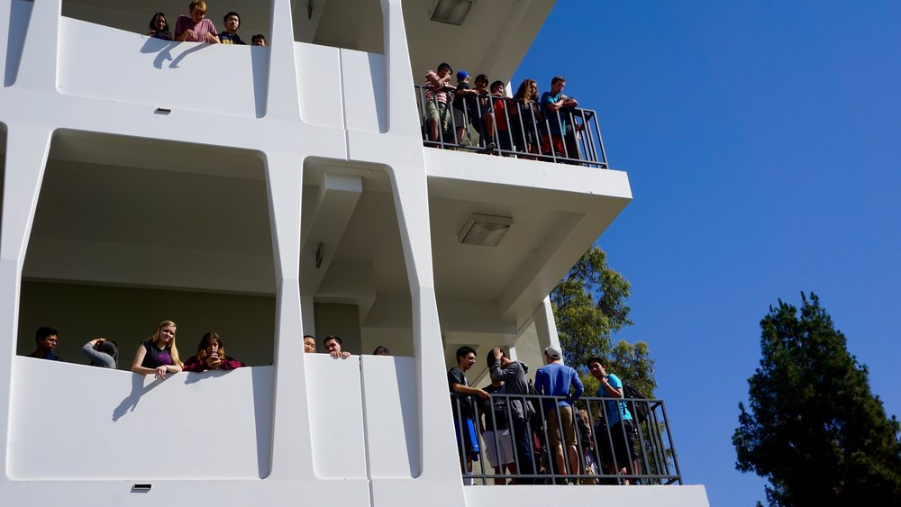 students looking from the railing