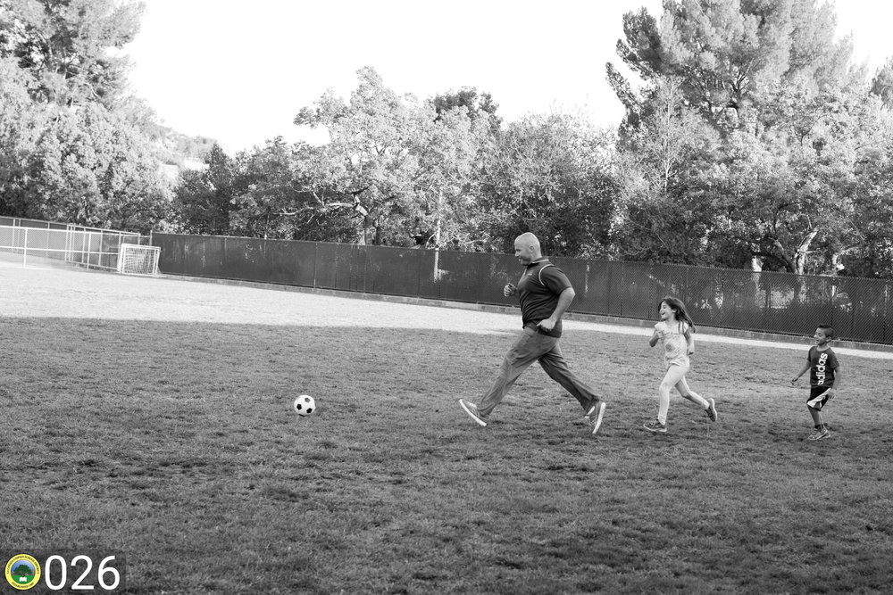 LCHS english teacher plays soccer with his children.