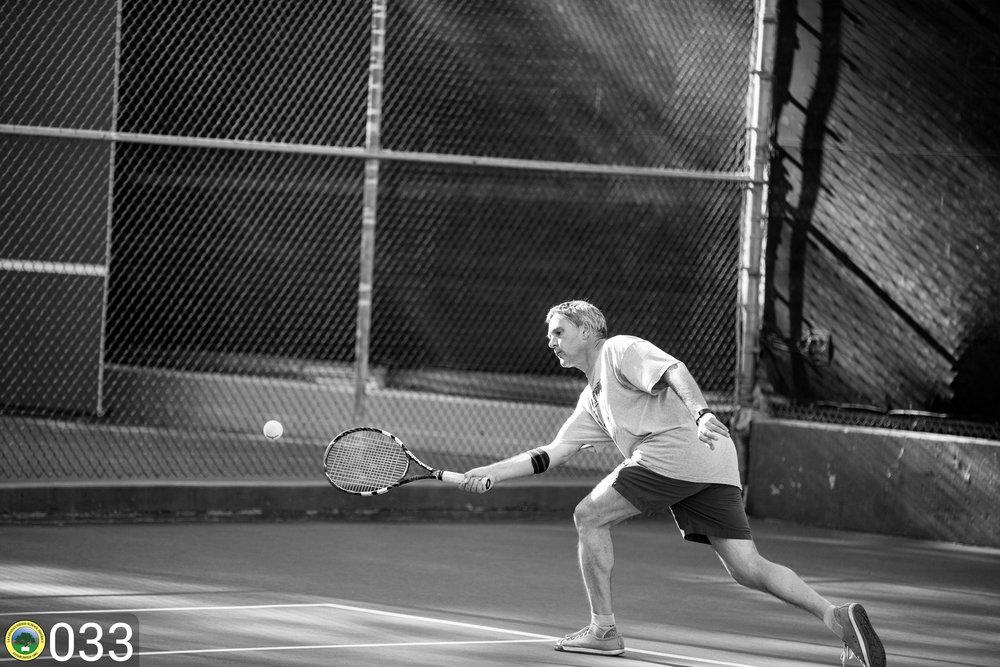 Teacher playing tennis.