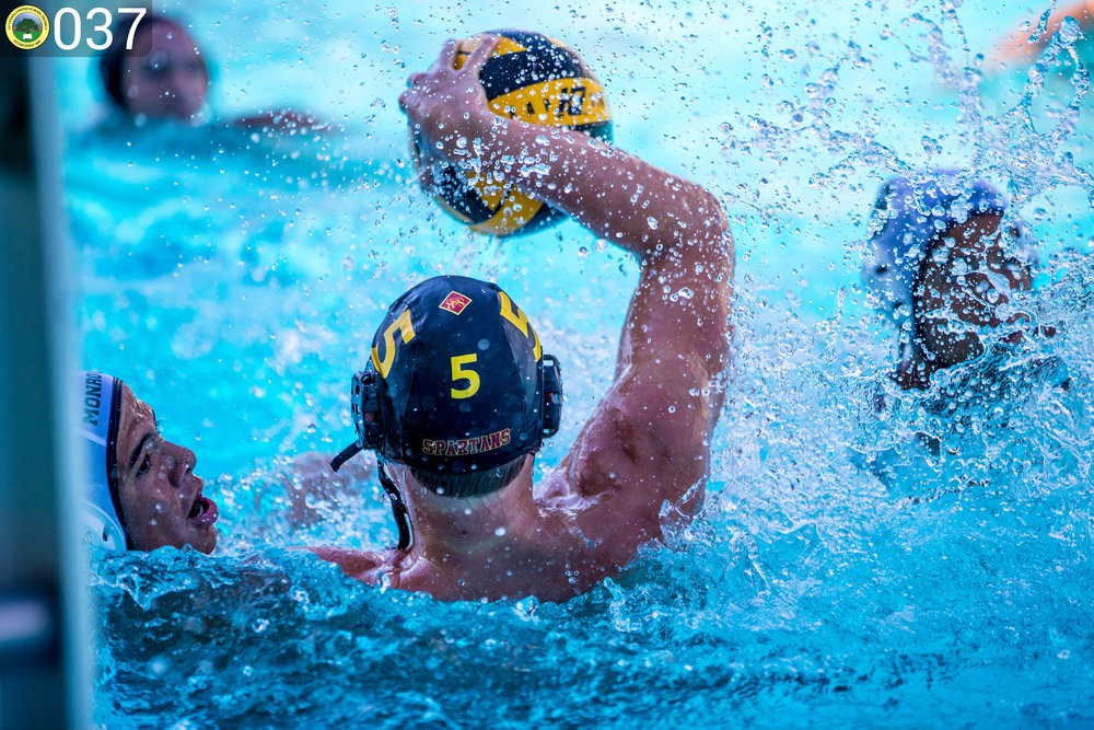 Spartan water polo player with the ball.