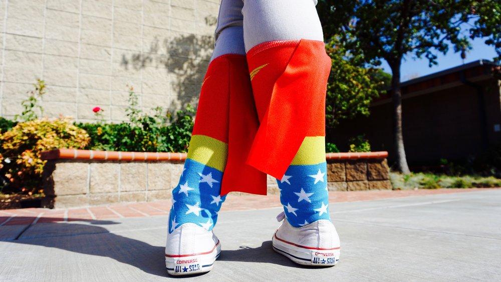 Student wearing Wonder Woman socks.