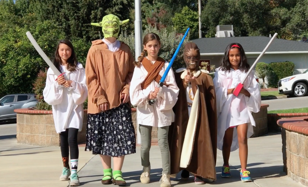 Kids dressed up as Star Wars characters.