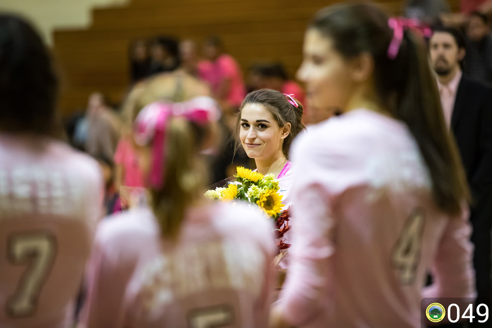 Girl Volleyball Player receives yellow flowers