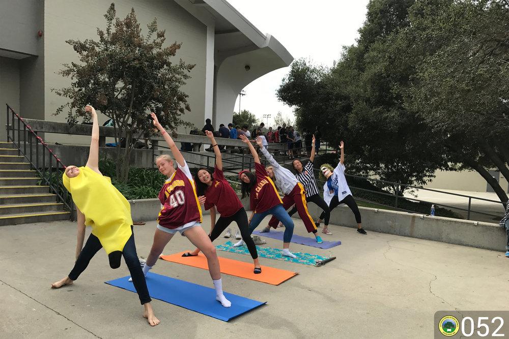 Students doing yoga.