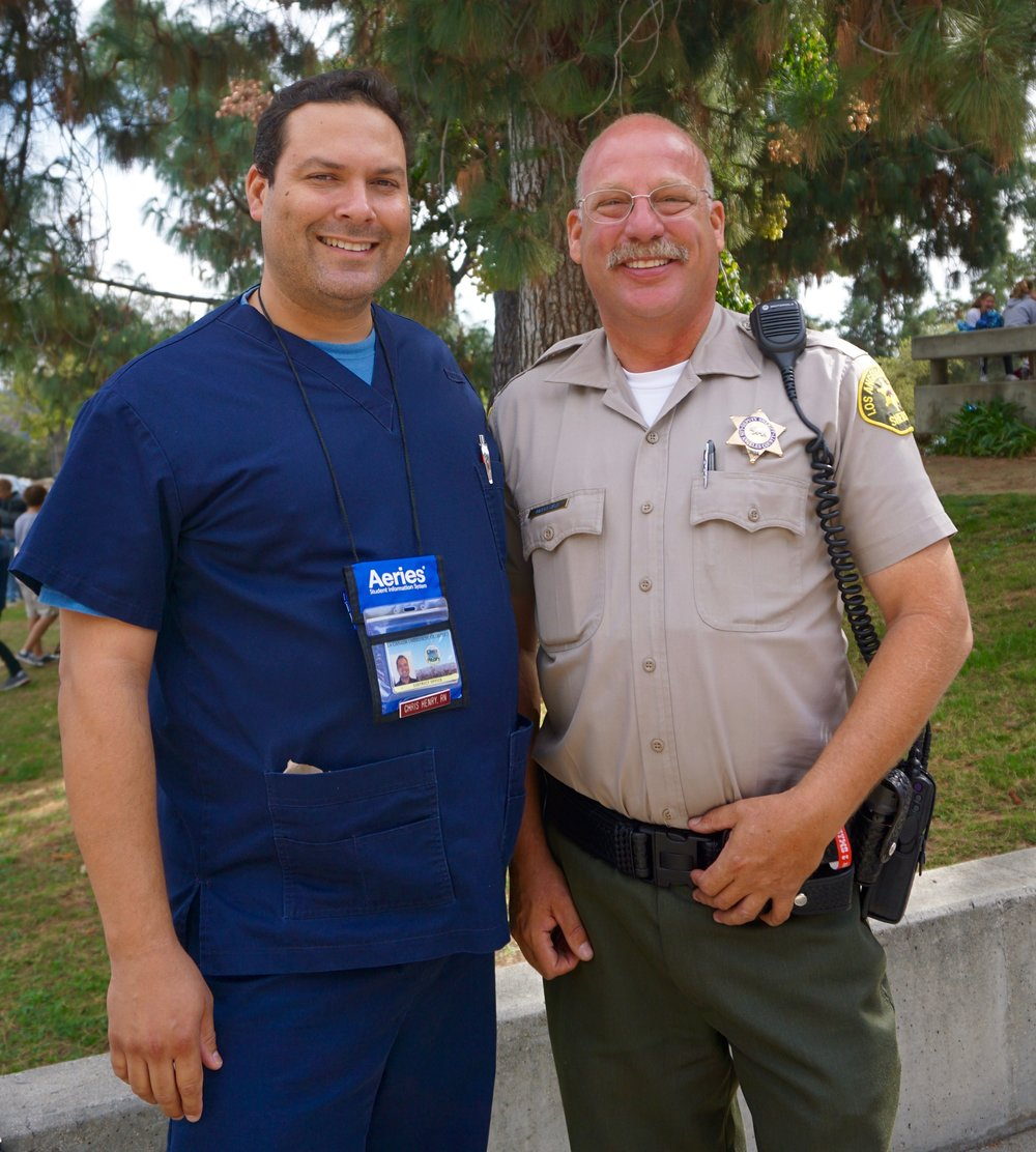 District Nurse and School Resource Officer Pose for the Camera.