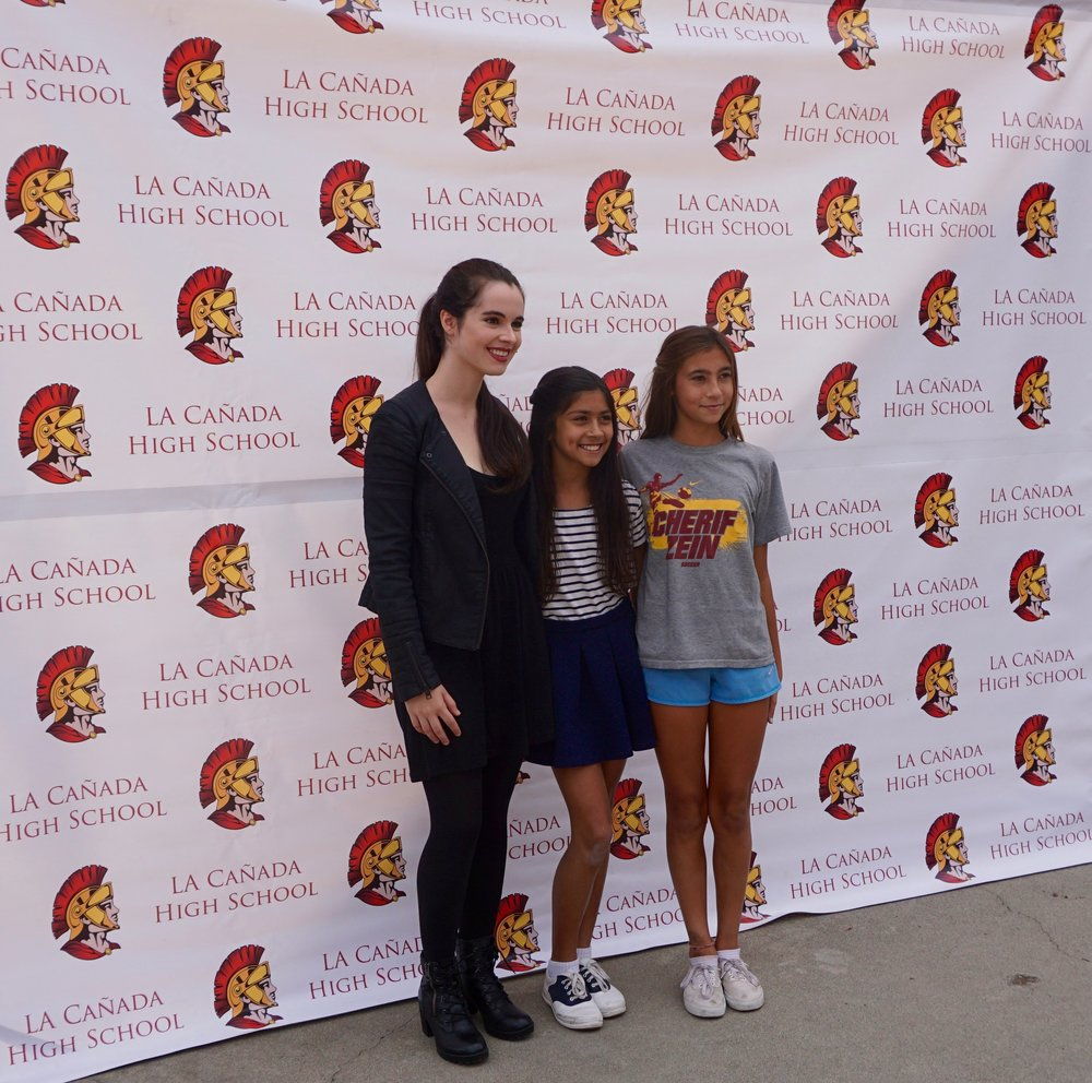 Vanessa Mardano poses with two students