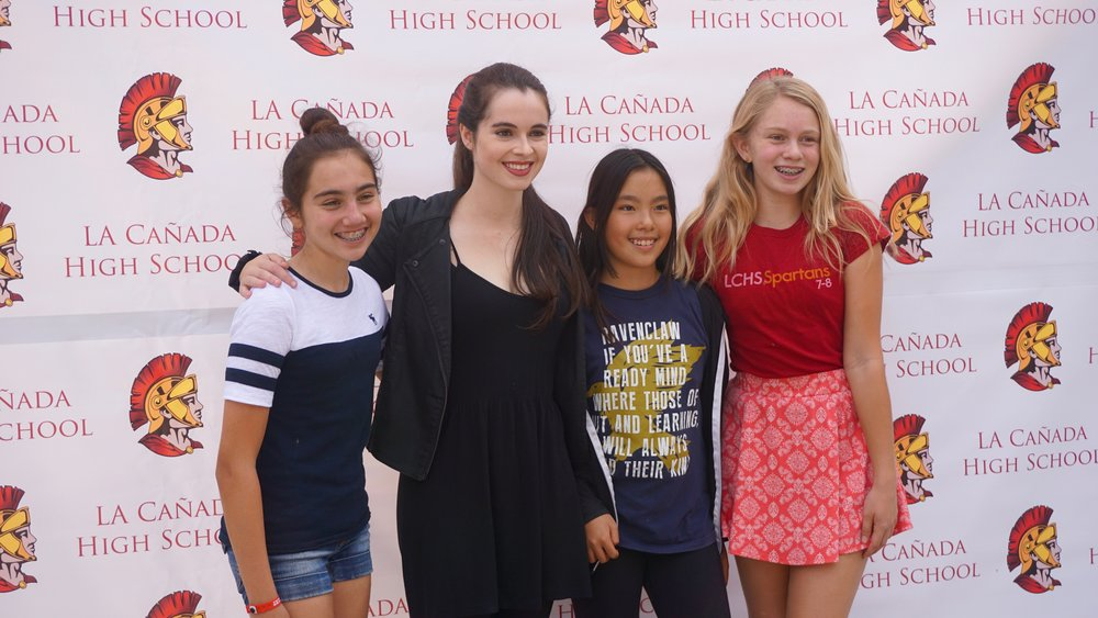 Vanessa Mardano poses with 3 students