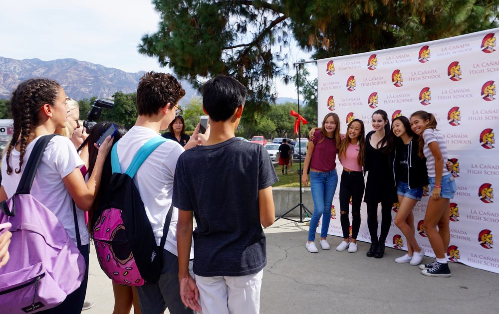 Students wait in line to take pictures with her