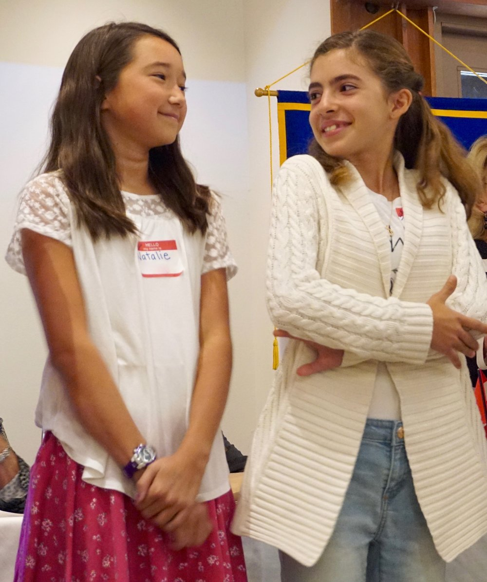 Two young girls at a Kiwanis meeting