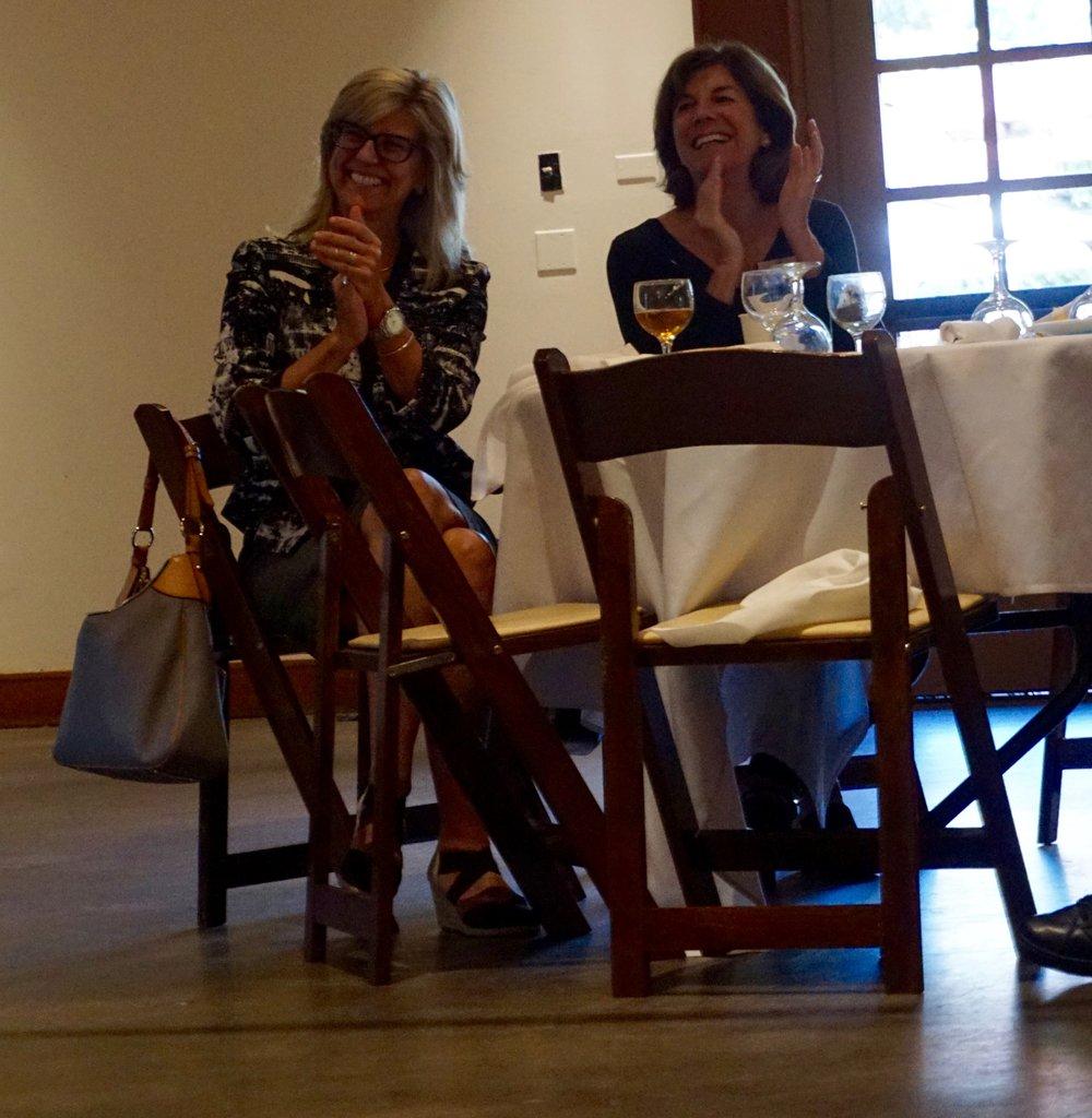 Two members having a good time at a Kiwanis meeting.