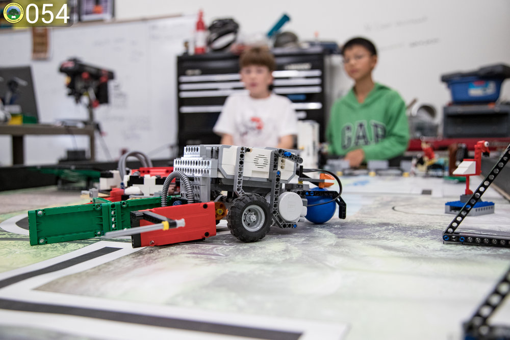Lego vehicle built by two boys.