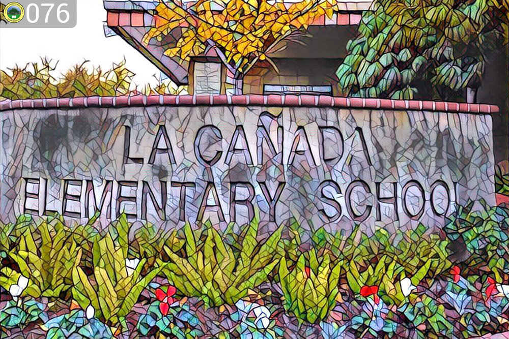 La canada elementary school sign with plants.