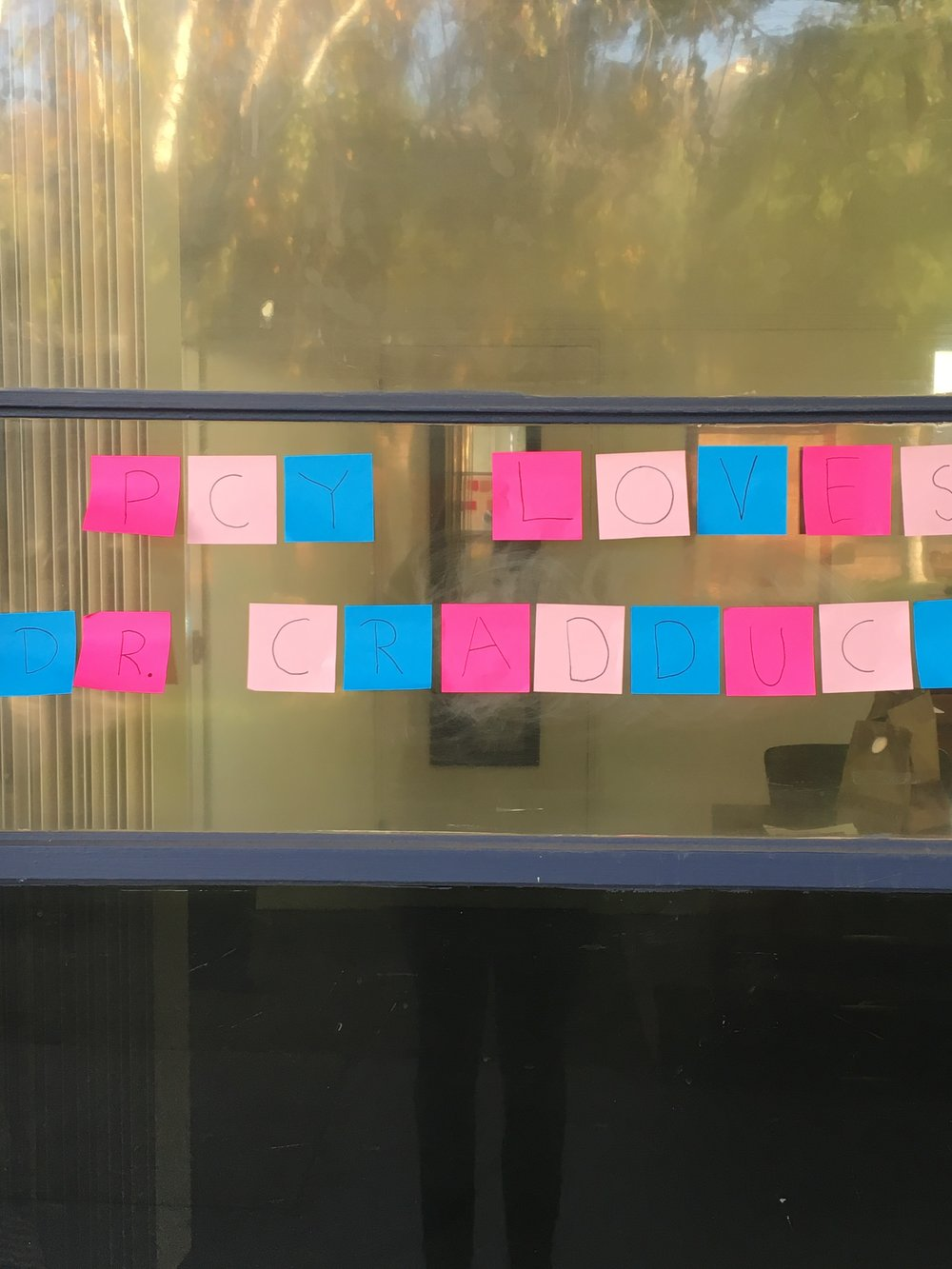 "Sticky notes on a window ""PCY loves Dr. Cradduck."""
